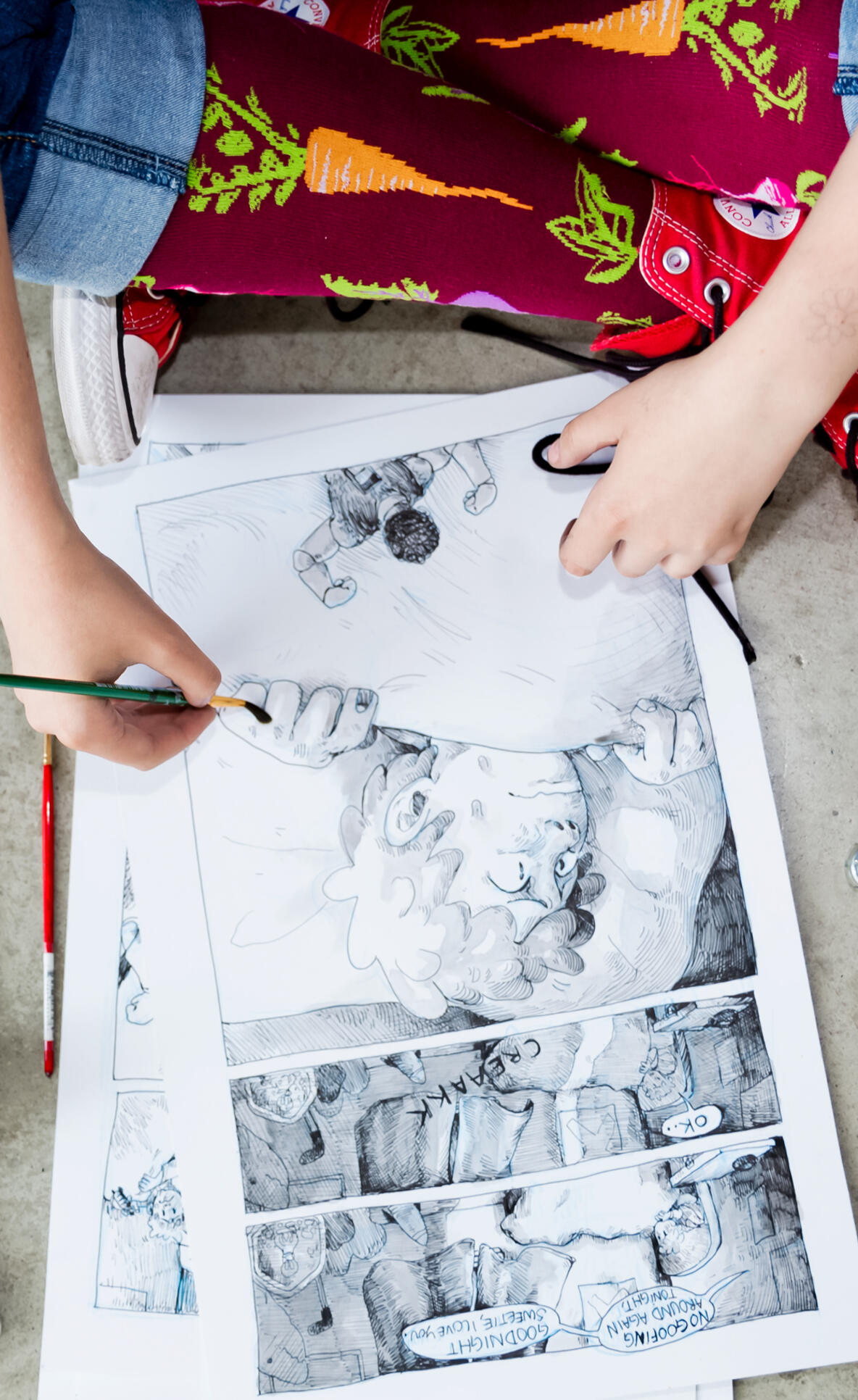 Overview shot of a student painting a comic