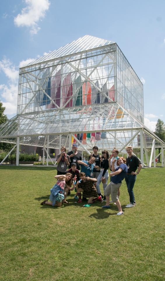 Pre-College students stand in front of a Walker sculpture
