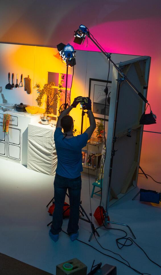 Student preparing a light in a film class