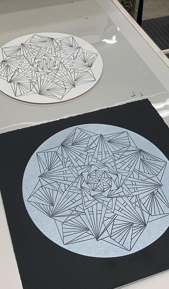 A geometric abstract black and white print ; Kara Gregory