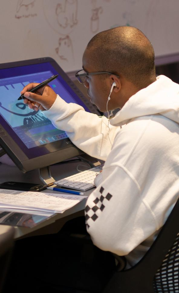 Student working on a wacom cintiq tablet in the animation studio