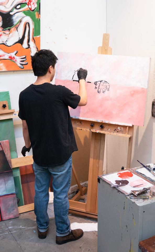 Person painting in their studio