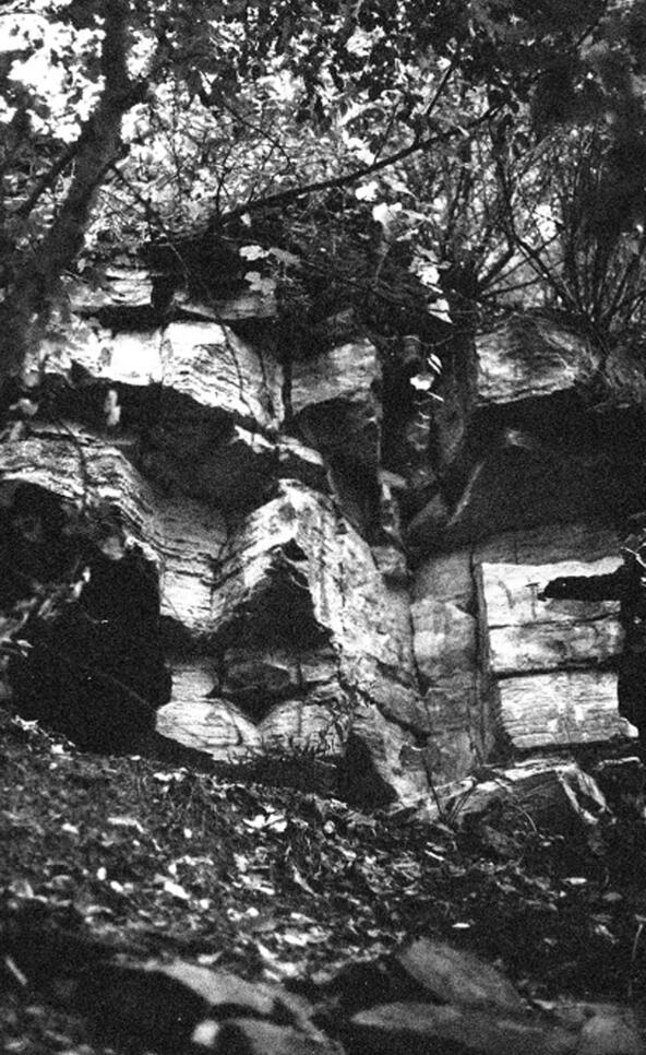 Black and white photograph of an entrance to a cave ; Jack Powers