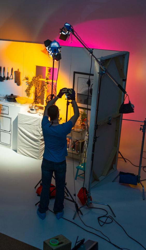 Student adjusting a film set