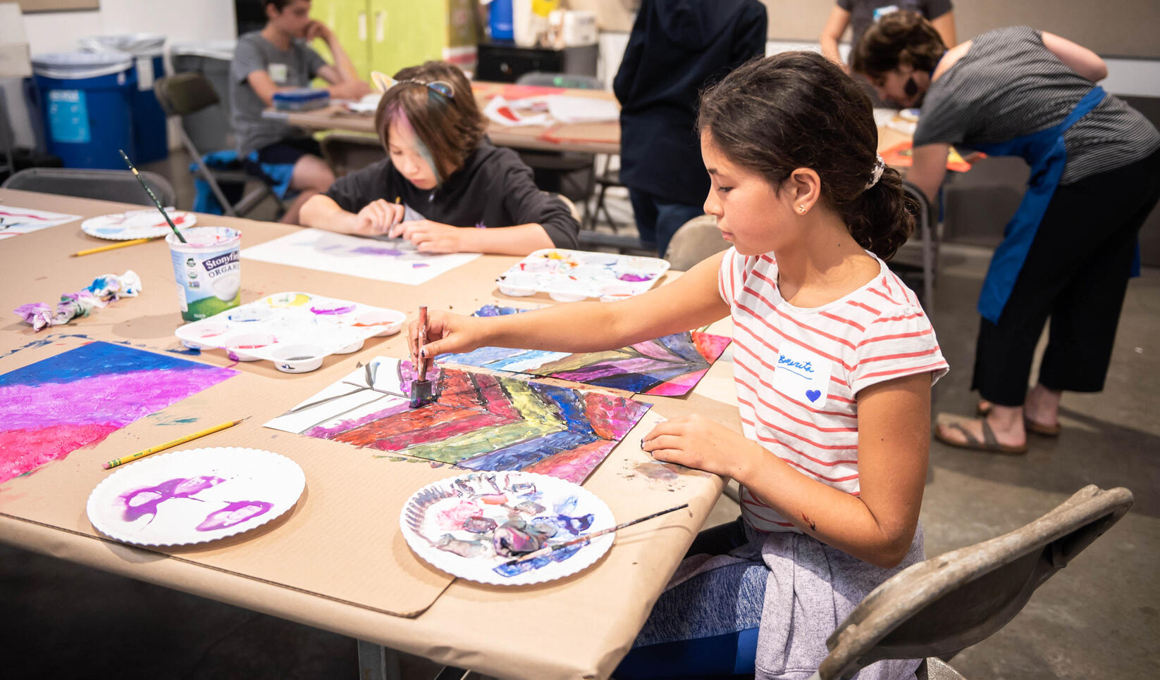 Student working on a painting at Summer Youth Camp