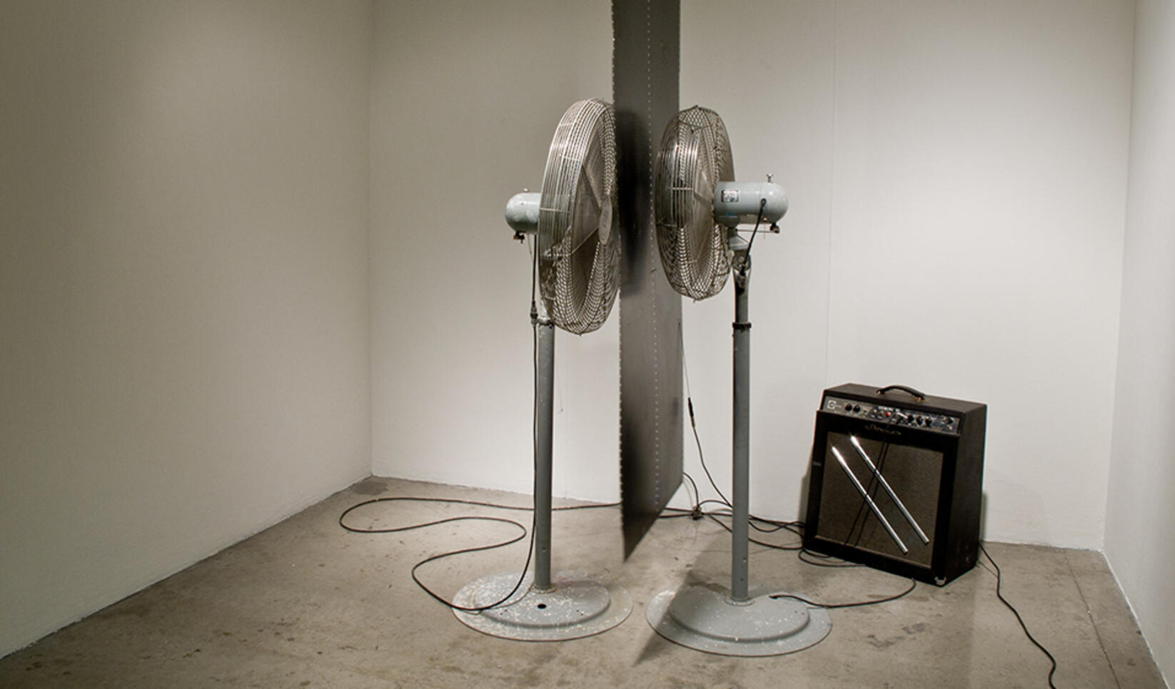 Two fans standing next to each other like a reflection ; Derek Ernster