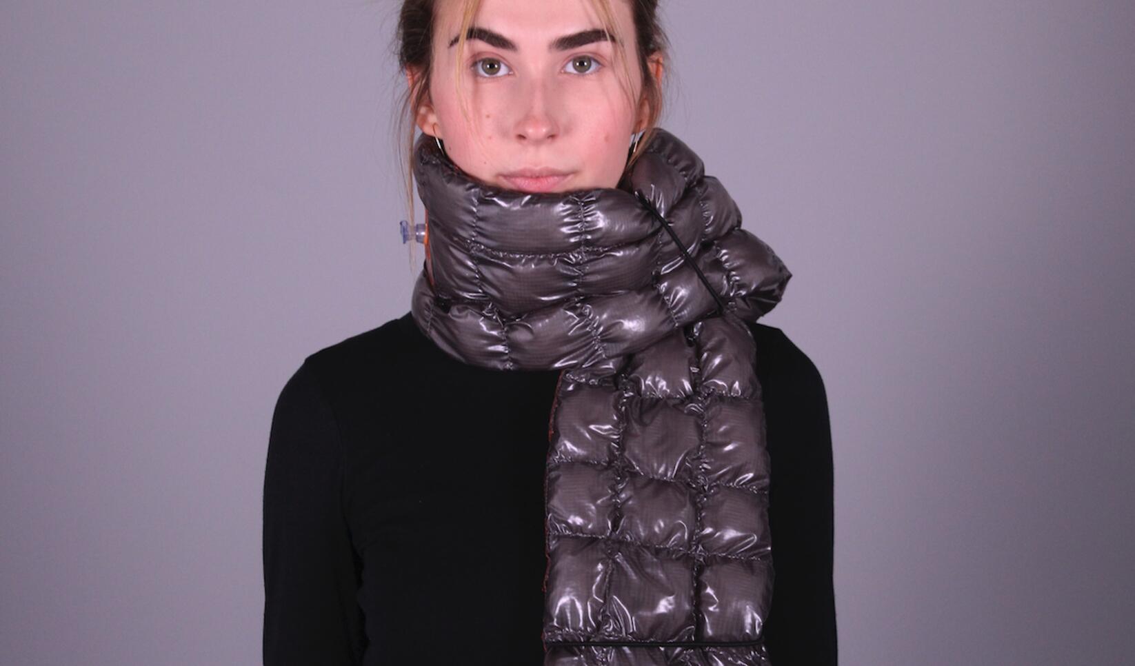 Model wearing an inflatable scarf product design. ; Zachary Wegscheid
