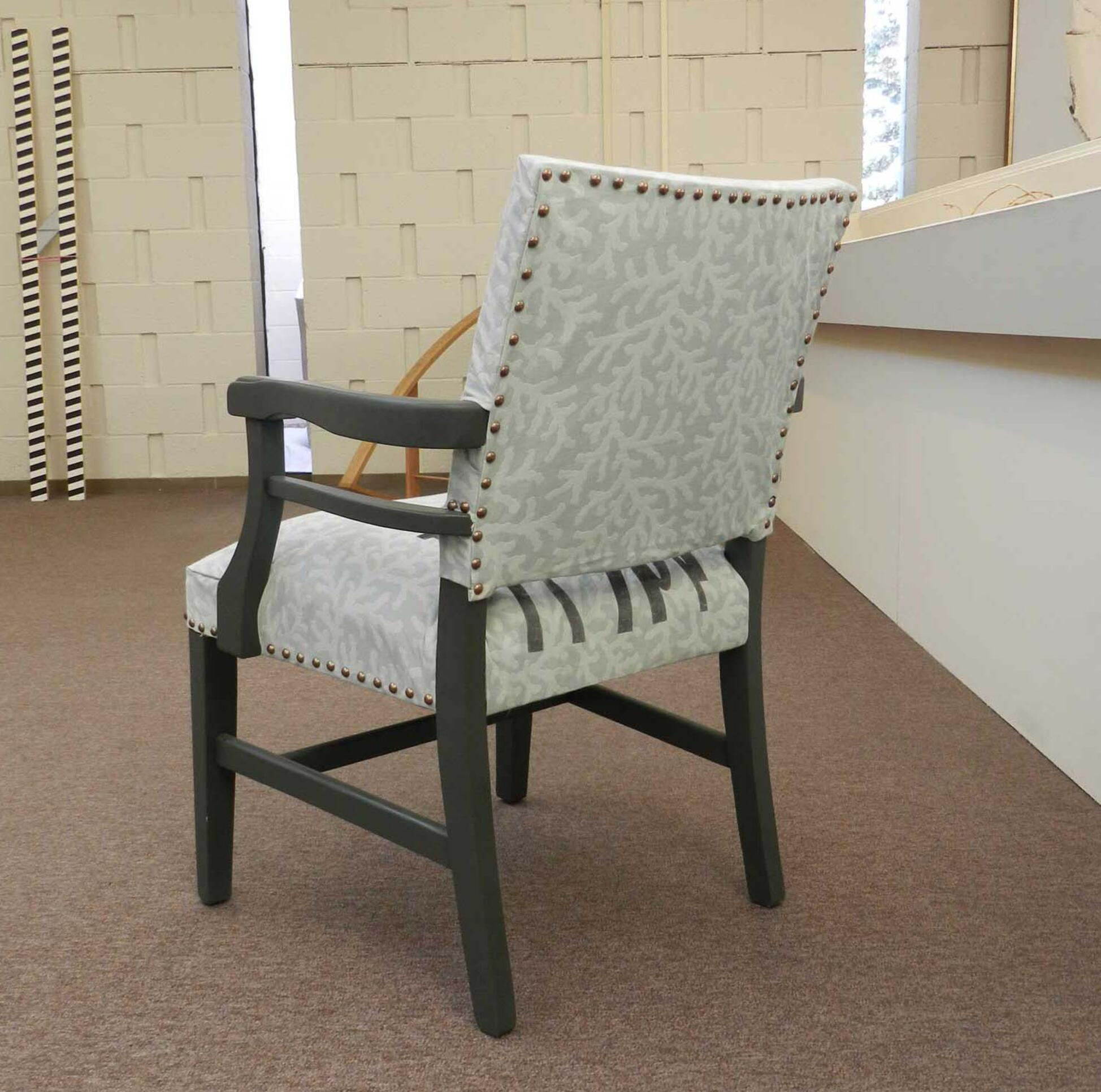 Screen printed fabric of grey and white on reupholstered chair.  ; Alexandra Graham