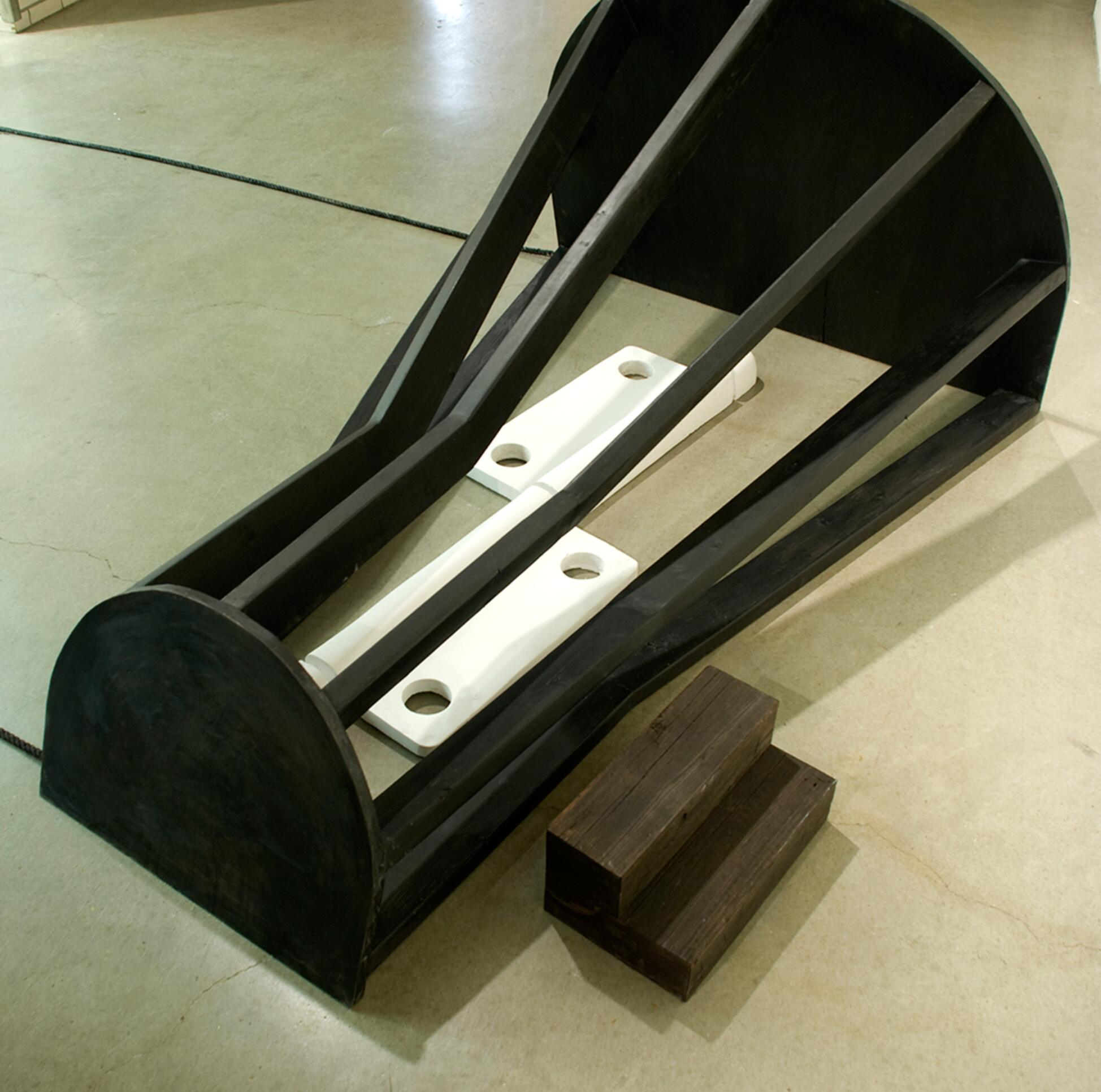 Installation sculpture mirroring the shapes of steps and semicircles.  ; Derek Ernster