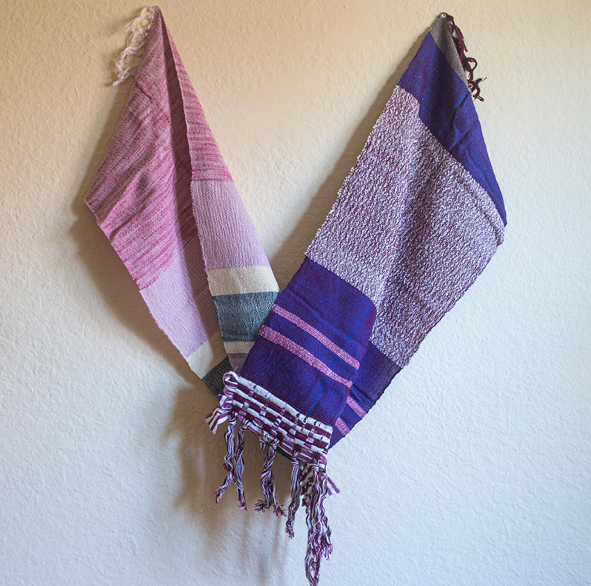 Installation of scarves weaving together ; Kehayr Brown-Ransaw