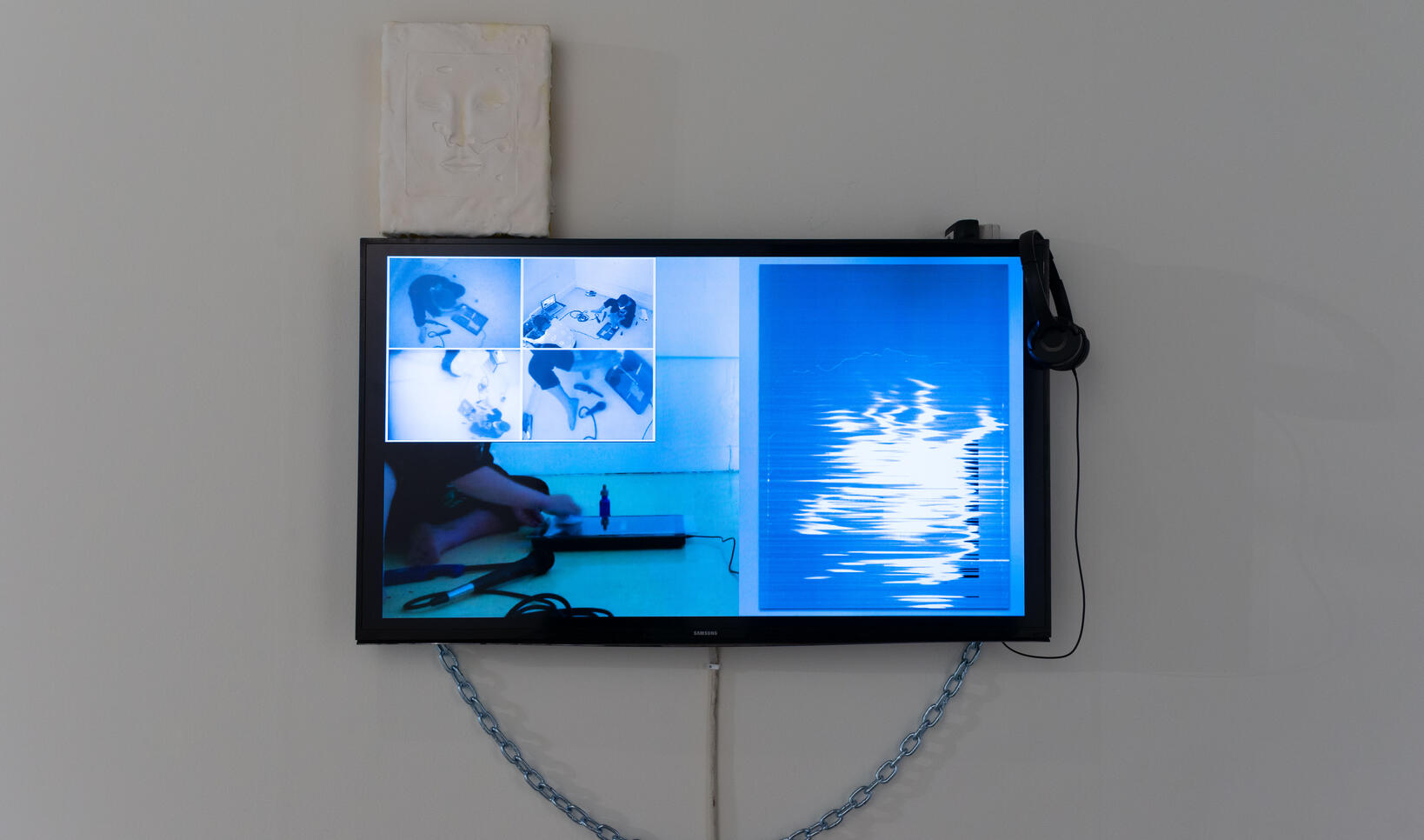 Installation of video rendered in shades of blue. ; Emma Beatrez